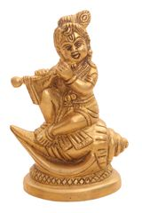 Brass Krishna Statue: Bala Gopal Avatar Seated On Holy Conch Panchajanya Shankh (10920)