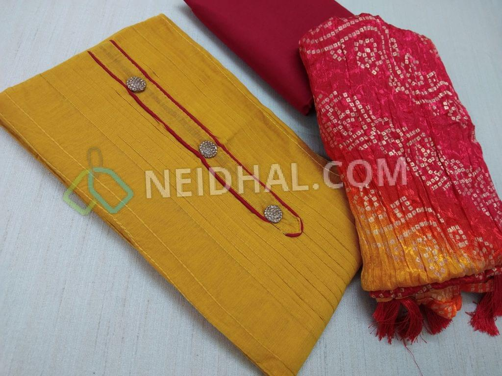 Designer Yellow Silk cotton unstitched salwar material(with lining) with fancy buttons, pintuck work on sides, plain back, Red silk cotton bottom, Bandhini printed Crush silk short width dupatta