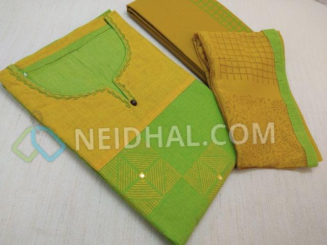 Premium Printed Green and Yellow Handloom Cotton Unstitched salwar material(requires lining) with neck stitch, thread work on neck line, block prints and foil mirror work on front side, yellow cotton bottom with green block prints, Block printed yellow chiffon dupatta with tapings .