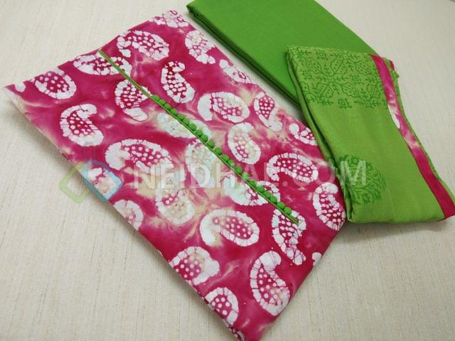 Premium Pink Cotton unstitched salwar material with potli buttons, Real Batik Bandhini work on both sides, Green cotton bottom, Block printed Green chiffon dupatta with taping.