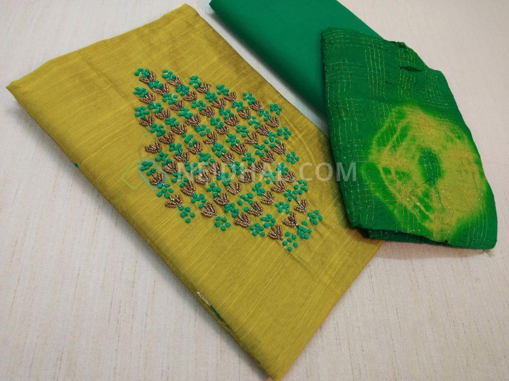 Mehandi Green unstitched salwar material(requires lining) with bead, french knot work on yoke, daman patch work, Turquoise green bottom bottom, Bandhi print and zari work on silk cotton dupatta(requires taping)