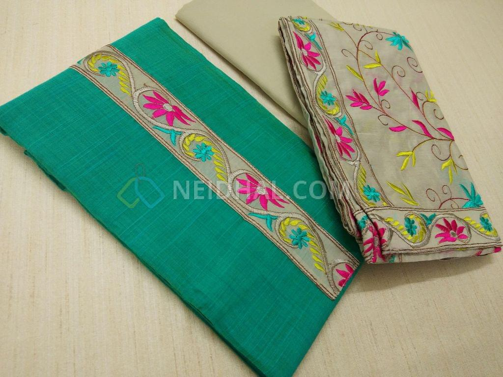 Turquoise Blue Chanderi Silk Cotton unstiched Salwar material(requires lining) with embroidery patch work on yoke, daman patch work, light Grey cotton bottom, Heavy colorful embroidery work on light Grey silk cotton dupatta with embroidery taping.