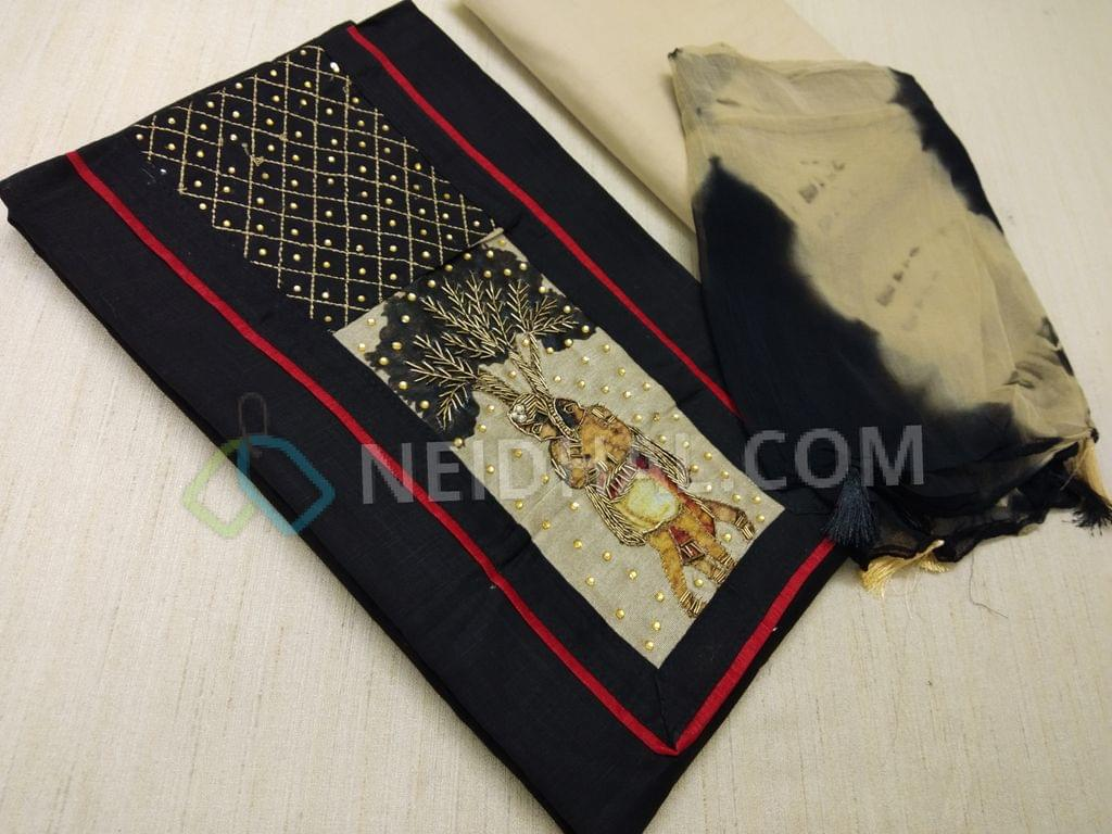 Black Slub cotton unstitched salwar material(requires lining) with Yoke patch work, zari, thread, bead and pipe work on yoke, daman patch, Cream cotton bottom, Shibori printed chiffon dupatta with tassels.