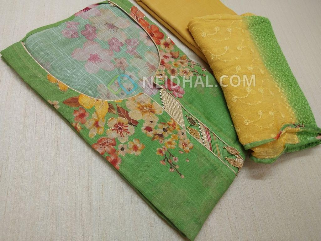Designer Green Linen unstitched salwar material(requires lining) with round collar, Floral printed patterns,Golden zari work front side, floral printed back, Peach Drum dyed cotton bottom, fancy tassels, Soft yellow drum dyed cotton bottom, Heavy embroidery work on multi color chiffon dupatta
