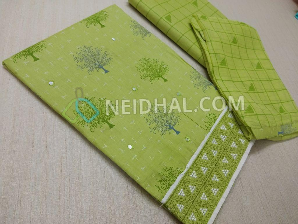 Printed Green Cotton unstitched salwar material(requires lining) with faux mirror work on front side, Heavy thread work on daman, Printed cotton bottom, Printed chiffon dupatta with taping.