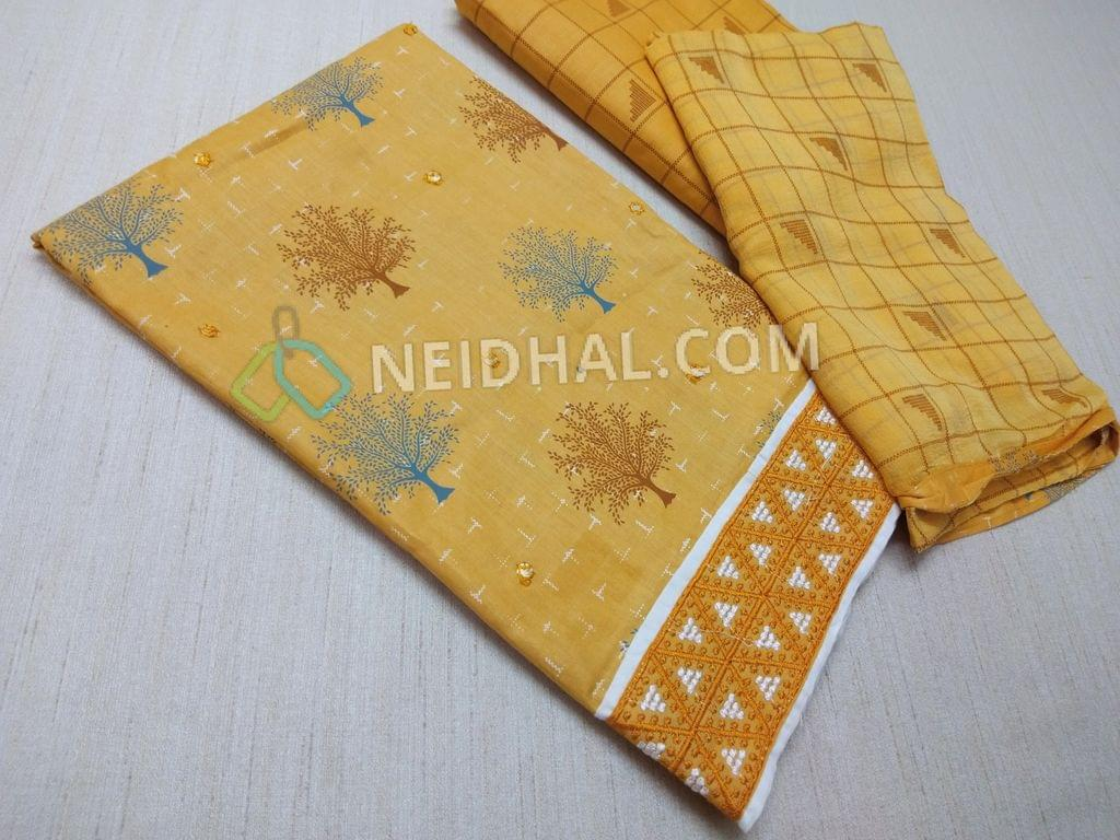 Printed Yellow Cotton unstitched salwar material(requires lining) with faux mirror work on front side, Heavy thread work on daman, Printed cotton bottom, Printed chiffon dupatta with taping.