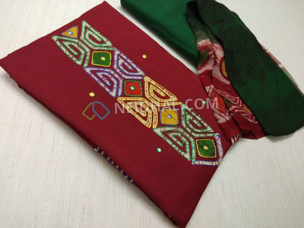 Premiun Maroonish Red Cotton unstitched salwar material with batik dye work patch on yoke, faux mirror and embroidery work, daman batik dye work patch with thread and faux mirror work, batik dyed on back side, Green cotton bottom, batik dye work on pure chiffon dupatta(taping required)(VIDEO IS JUST FOR REFERENCE, EMBROIDERY PATTERNS AND PRINTS ARE DIFFERENT IN CURRENT DESIGN)