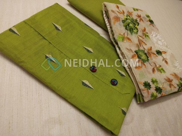 Green dupian Silk Cotton unstitched Salwar material(requires lining) with fancy buttons, weaving patterns, drum dyed soft cotton bottom, Beige kora dupatta with heavy colorful thread work and taping