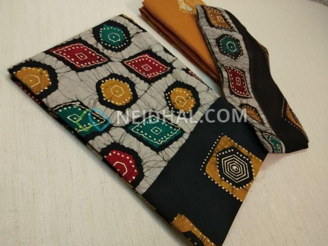 Premium wax Batik Printed Black Cotton Unstitched salwar material(requires lining) with Golden prints, plain back,Yellow Wax batik soft drum dyed cotton bottom, batik pure chiffon dupatta(requires taping)