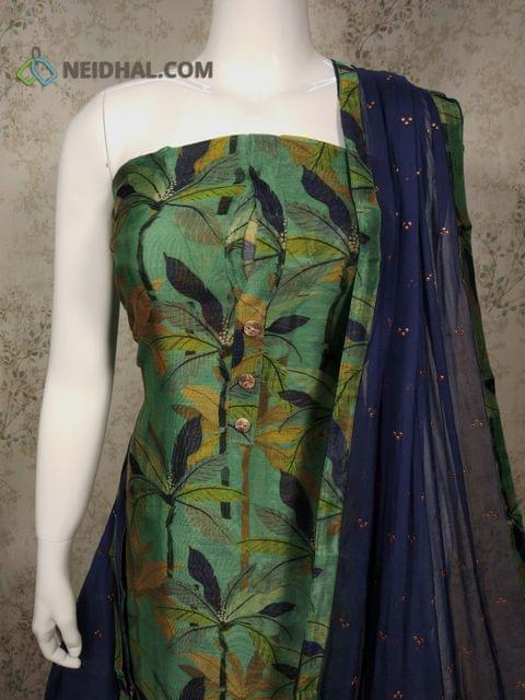 Premium Digital Printed Green Silk Cotton Unstitched(requires lining) salwar material with buttons on yoke ,navy blue cotton bottom, Golden dew drops on navy blue chiffon dupatta with tapings.