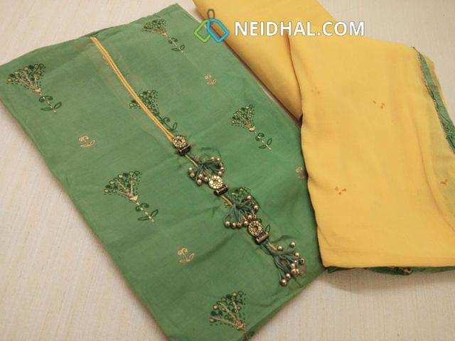 Premium Floral Printed Green Masleen Unstitched salwar material(requires lining) with zari thread work on front side, fancy tassels on yoke, yellow cotton bottom, golden dew drops on chiffon dupatta with tapings