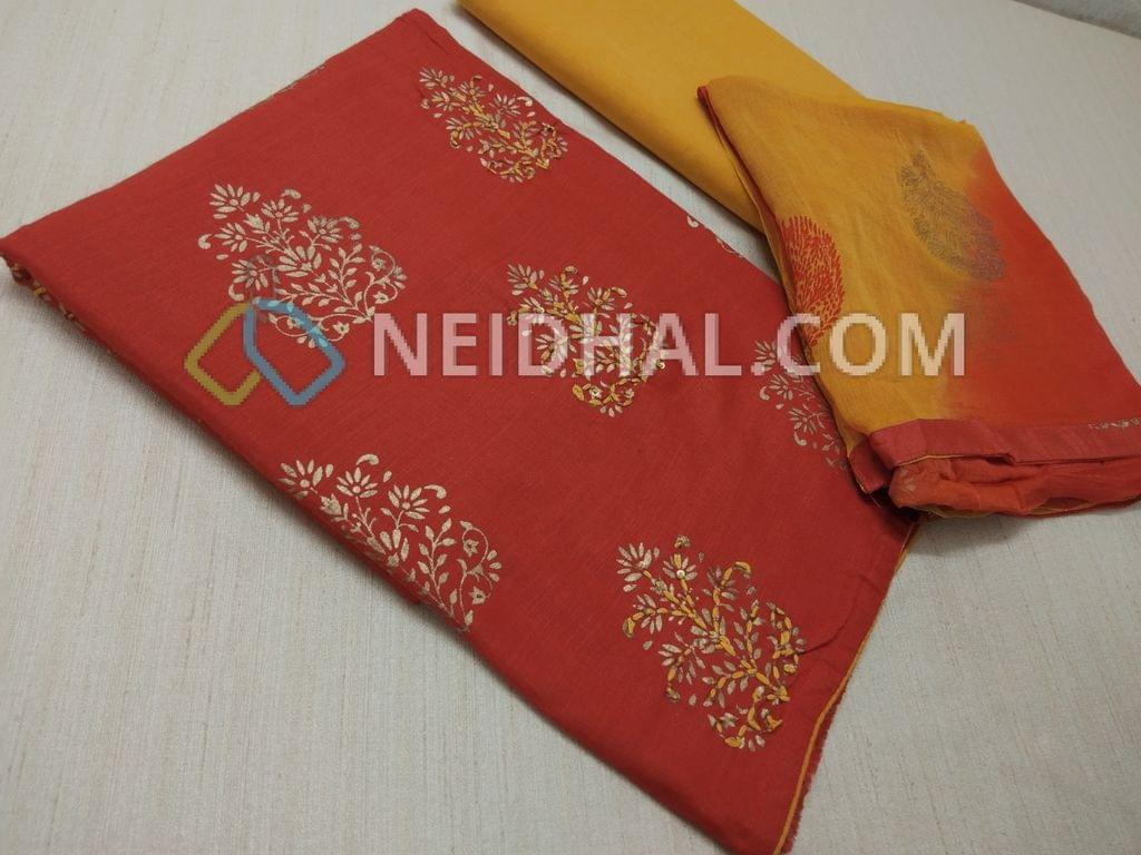 Brick Red Modal Fabric(Flowy Fabric, requires lining) with Gloden prints, Thread and sequins work on front side, Yellow cotton bottom, Block printed multi color nazneen dupatta with tapings.