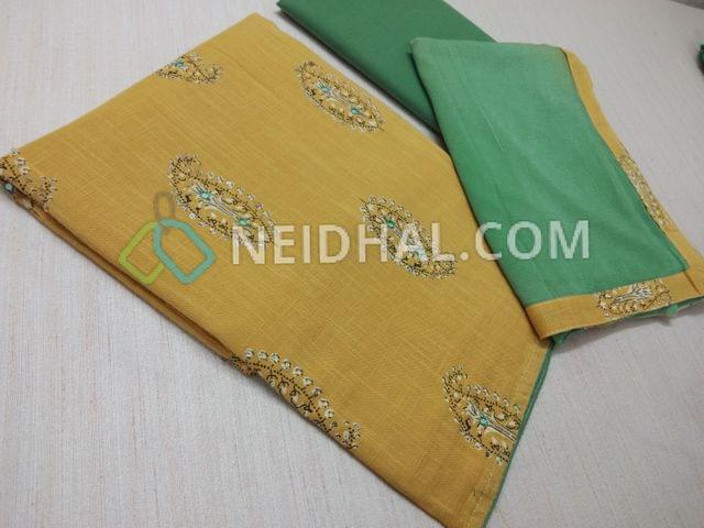 Yellow Slub Cotton unstitchd Salwar material with sequins work on prints patterns, faux mirror work on front side, turquoise blue cotton bottom, Multi color nazneed dupatta with taping