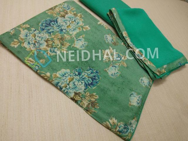 Floral Printed Green Modal fabric(flowy fabric, requires lining) with golden prints, aqua Blue cotton bottom, Aqua Blue nazneen dupatta with taping
