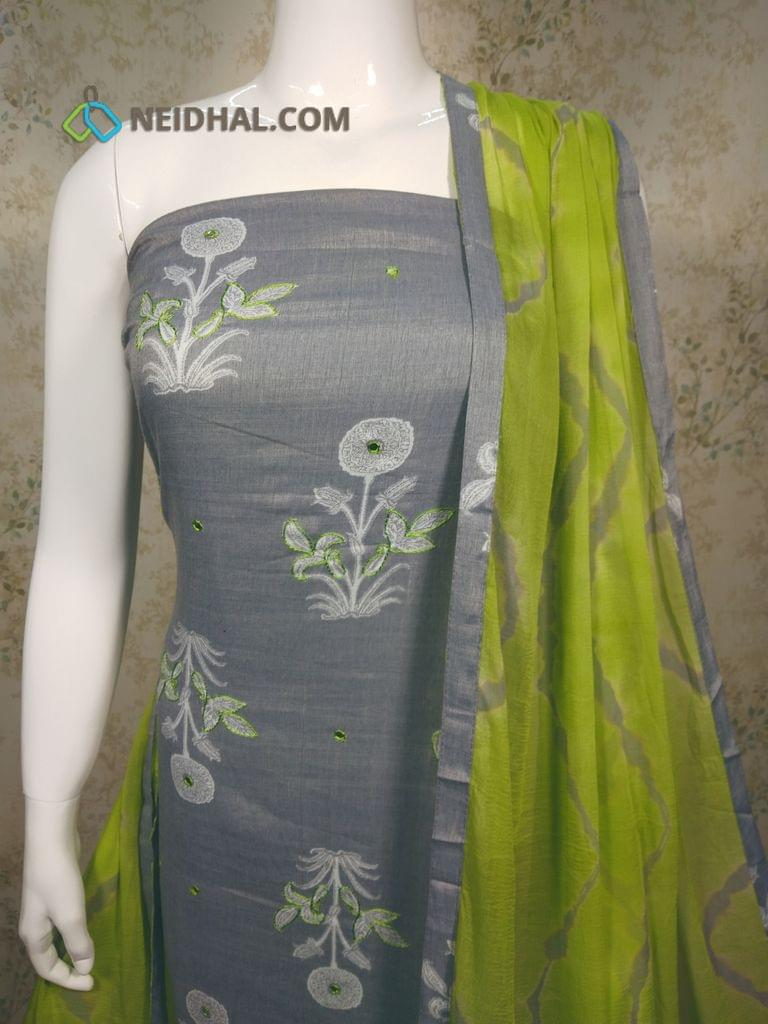 Printed Grey Liquid fabric unstitched salwar material with thread and foil mirror work on front side, green Cotton bottom,printed green chiffon dupatta with tapings.
