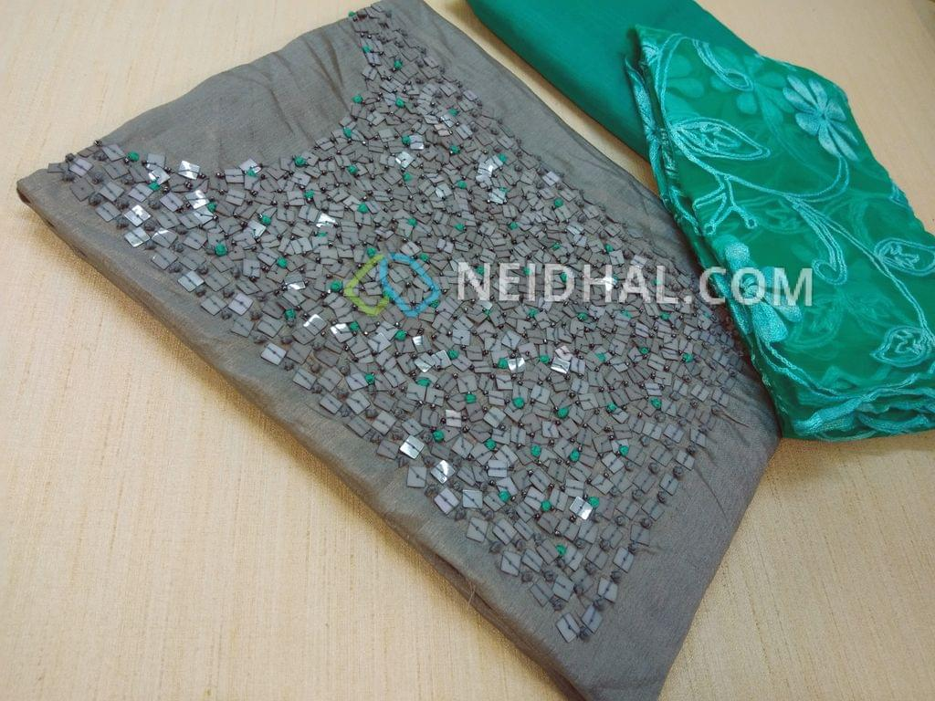 Designer Grey Shimmer type Unsitched salwar material(thin fabric equires lining) with heavy bead, french knot and hand work on yoke, daman patch, Green cotton bottom, Green super net dupatta with heavy thread work (Taping might be required)