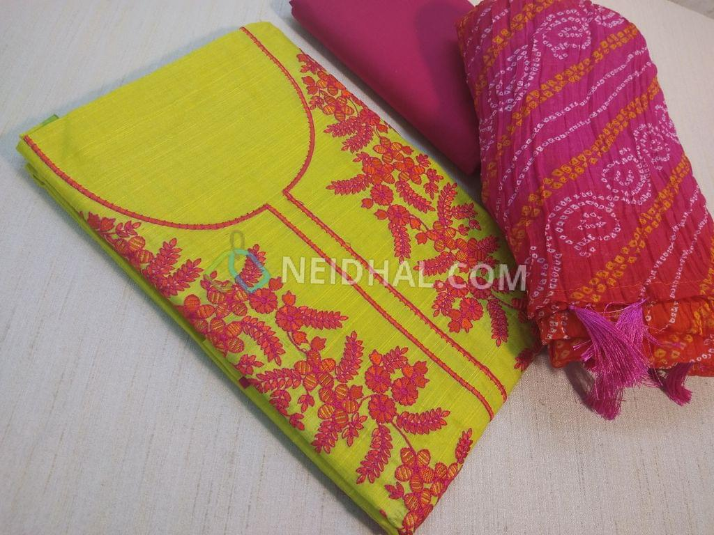 Bright Mehandi Green unstitched salwar material(requries lining) with thread work on yoke, daman patch, pink cotton bottom, bandhini printed chiffon dupatta with tassels(reauires taping on sides)