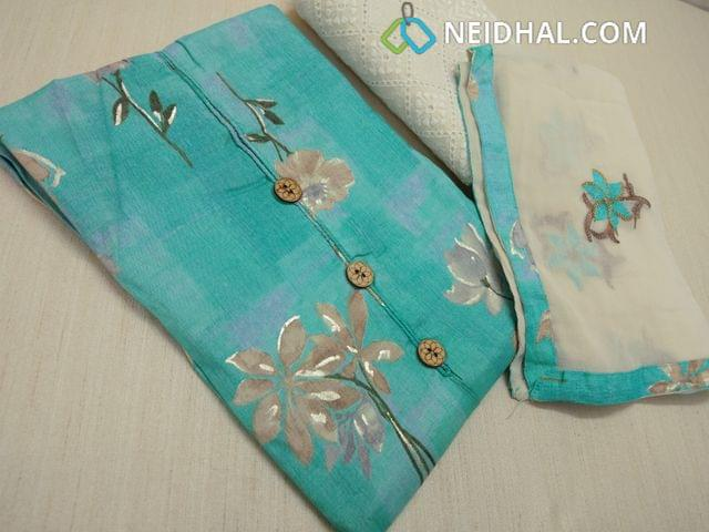 Designer Digital Floral printed on Blue liquid fabric with with wooden buttons, Chigan work on cream cotton bottom, cream Chiffon dupatta with heavy floral embroidery work and tapings.