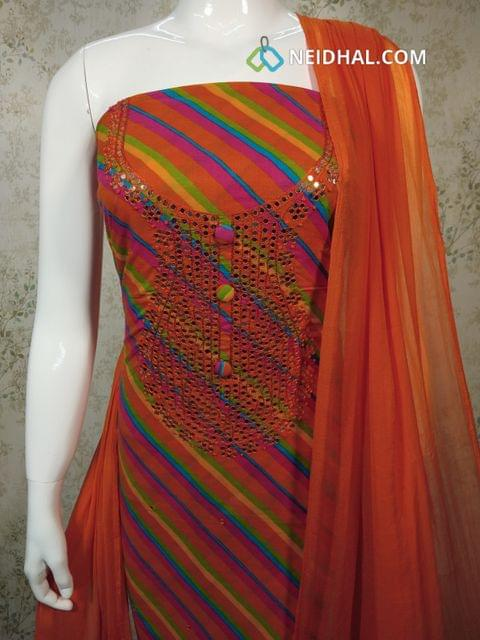 Printed Multicolor Cotton Unstitched salwar material with foil mirror, french knot work on yoke,  orange cotton bottom, orange chiffon dupatta with tassels.