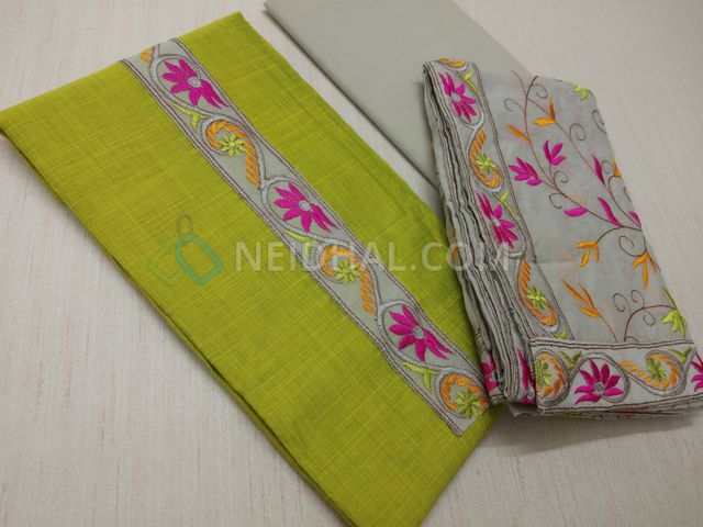 Turquoise Green Chanderi Silk Cotton unstiched Salwar material(requires lining) with embroidery patch work on yoke, daman patch work, light Grey cotton bottom, Heavy colorful embroidery work on light Grey silk cotton dupatta with embroidery taping.