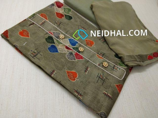 Printed Khaki Green Satin cotton unstitched salwar material(requires lining) with fancy buttons, Khaki Green cotton bottom, Khaki Green chiffon dupatta with taping.