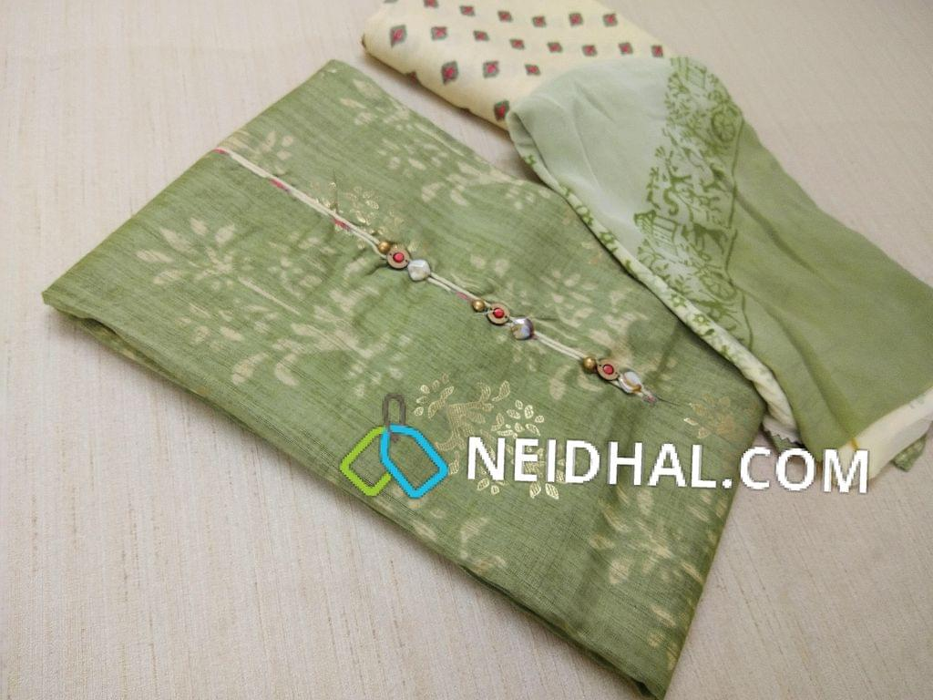 Green Printed liquid fabric unstitched salwar material( Flowy and soft fabric requires lining) with fancy buttons on yoke, printed cream modal(flowy fabric) bottom, Block printed chiffon dupatta with taping