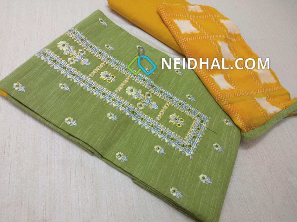 Green Slub Cotton unstitched salwar material(requires lining) with embrodiery work on yoke, embroidery butta work on front side, yellow cotton bottom, printed chiffon dupatta with taping