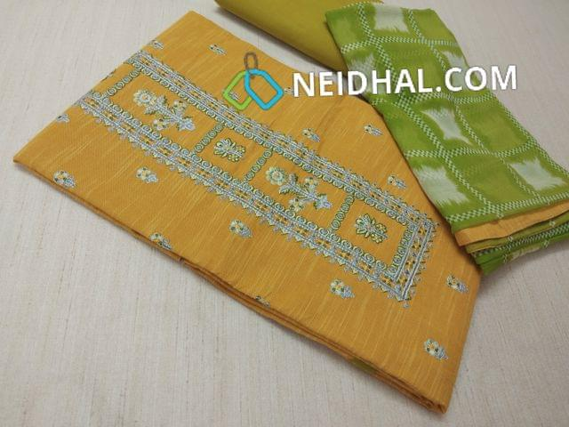 Yellow Slub Cotton unstitched salwar material(requires lining) with embrodiery work on yoke, embroidery butta work on front side, Green cotton bottom, printed chiffon dupatta with taping