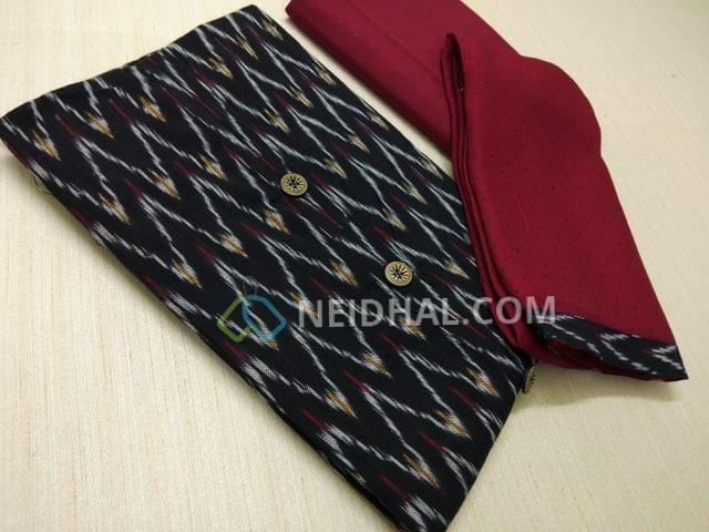 Black Pure Hand woven ikkat Cotton Unstitched salwar material(This Product has been woven by hand and may have weaving irregularities, missing tread in weft or warp, this may not be considered as damage, Please buy only if you are very sure about hand woven products), maroon cotton bottom, Printed Maroon Chiffon dupatta with taping.
