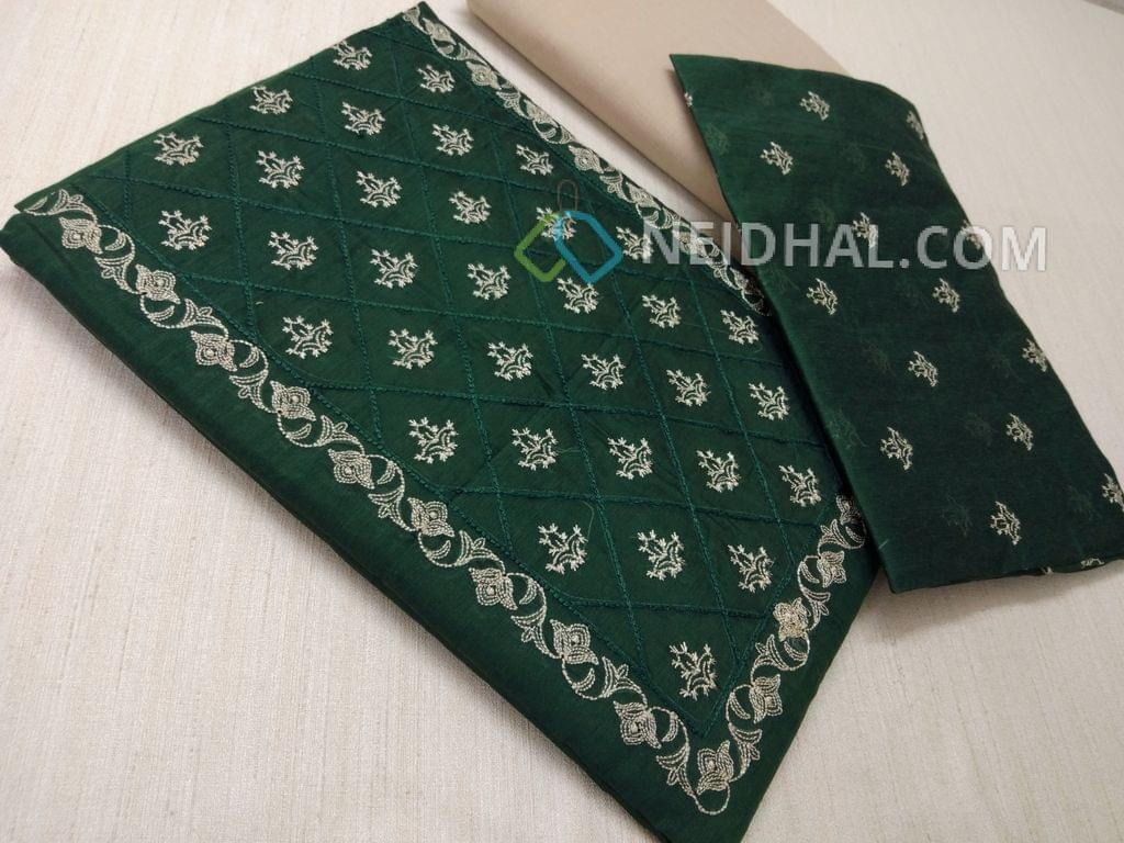 Green Silk cotton unstiched salwar material(requires lining) with embroidery work on yoke, embroidery work on front side, plain back, beige cotton bottom, Green silk cotton dupatta with embroidery work taping