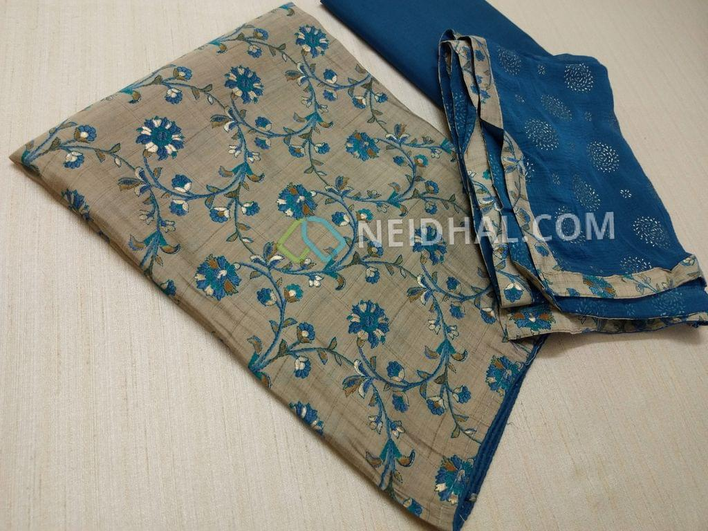 Floral Printed Silver Grey Semi masleen unstitched salwar material(thin fabric, requires lining) , Blue cotton bottom, emboss printed dupatta with taping