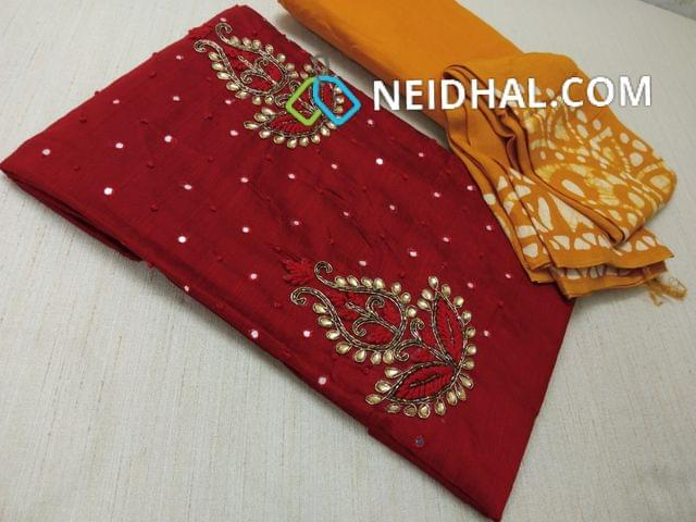 Maroonish Red Dupian Silk Unstitched salwar material( with French knot work, Faux mirror work, stone and pipe work on yoke, daman patch, Yellow cotton bottom, Yellow soft Pashmina Dupatta with Wax batik work and tassels(requires taping)