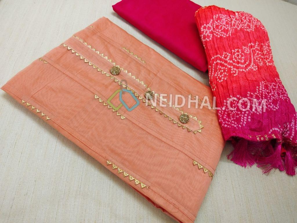 Designer Peachish Pink Silk cotton unstitched salwar material(lining required) with fancy buttons, pintuck work on sides, fancy golden stitch inserts on front side, plan back, Pink silk cotton bottom, Bandhini printed Crush silk short width dupatta with tassels