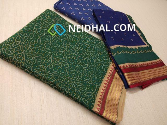 Bhandini Printed Green Soft cotton unsitched salwar material(requires lining) with traditional weaving daman, block Printed Blue cotton bottom, PRinted multi color cotton dupatta(taping needs to be stitched)