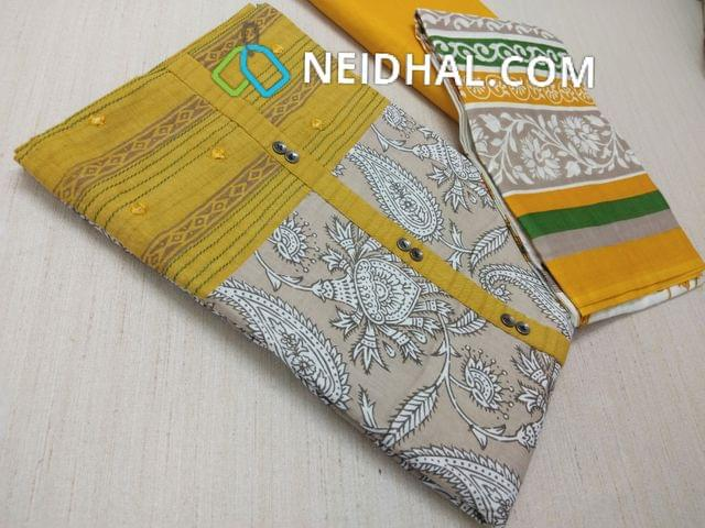 Beige Kalamkari printed Cotton unstitched Salwar material(requries lining) with Yellow patch work on topline, fancy buttons, Yellow Cotton bottom, printed cotton dupatta (VIDEO IS FOR REFERENCE ONLY, SUIT IN VIDEO HAS DIFFERENT DESIGN)