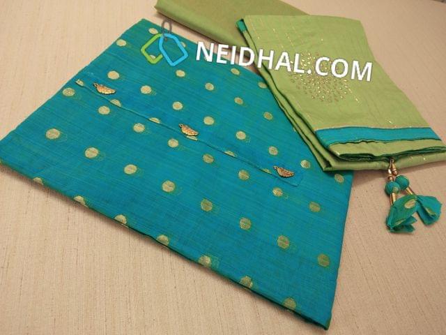 Diwali Collection: Designer Blue Chanderi Silk Cotton Unstitched salwar material(requires lining) with butta work, fancy tassels, Green Silk cotton bottom, Soft green Silk cotton dupatta with dew drops work and zari lines, Fancy ball tassels.