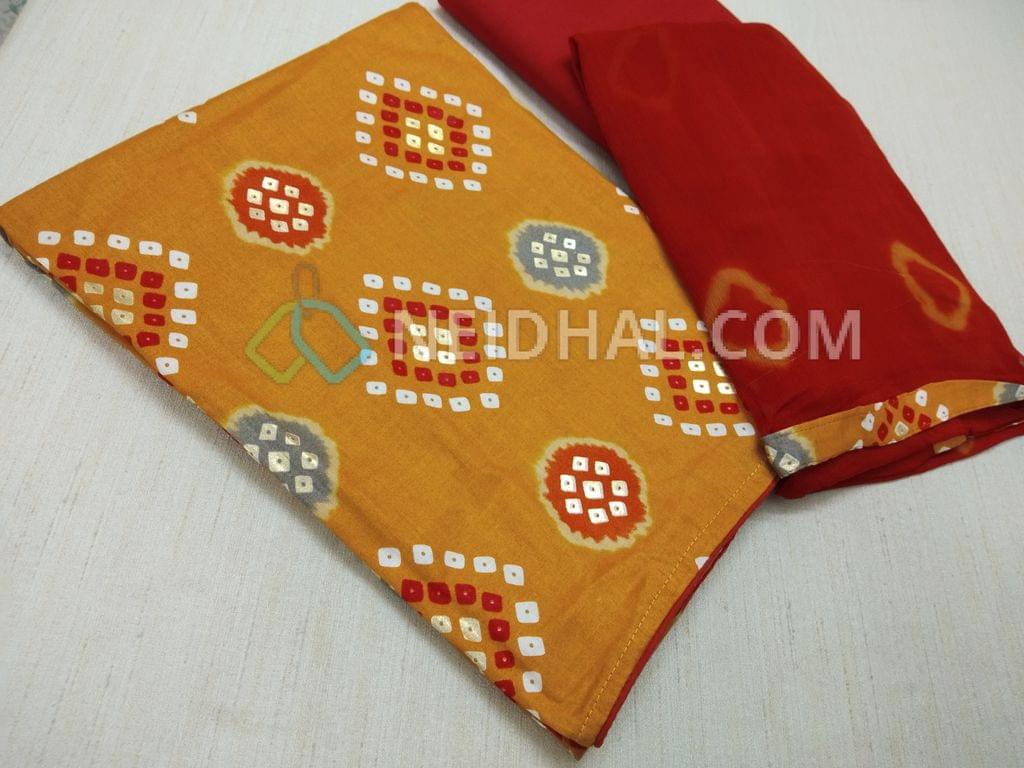 Bhandini Printed Yellowish Orange Cotton unstitched salwar material, with golden prints, Red cotton bottom, Red Chiffon dupatta with  Bandhini prints and taping