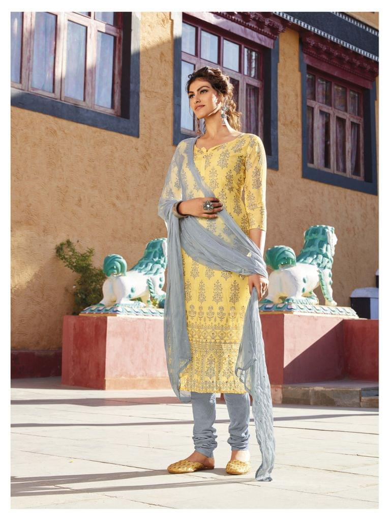Designer Printed Yellow Masleen silk unstitched salwar material(requries lining) with neck pattern, fancy buttons, Grey cotton bottom, Grey georgette dupatta with dew drops work and taping.