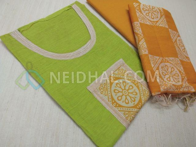 Green Silk Cotton unstitched salwar material(requries lining) with round neck pattern, yoke patch work, Yellow Cotton bottom,  Block printed(there might be overlap of prints, inconsitency in prints as these are charactersics of block prints) Yellow Silk cotton dupatta (requires lining)