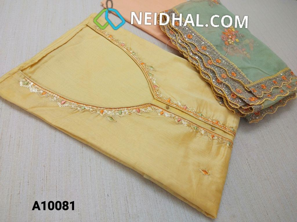 CODE A10081 : Designer Yellow thin Silk Cotton unstitched Salwar material(requires lining) with neck pattern, sequins and thread work on yoke and front side, peach cotton bottom, light green organza duptta with sequins, thread work and heavy work taping.