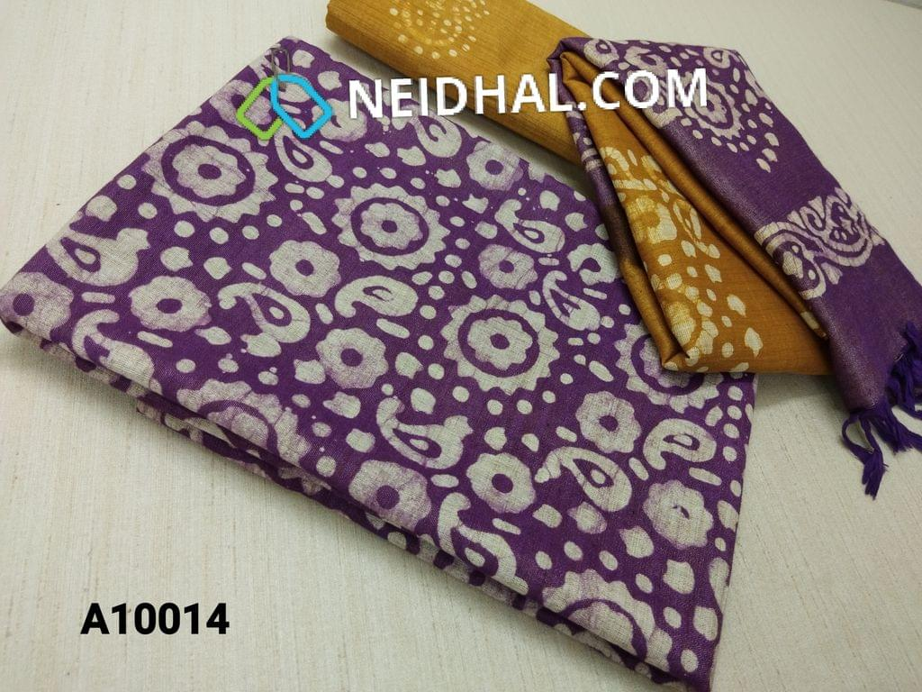 CODE A10014 : Batik Printed Purple Bhagalpuri cotton silk(thick fabric, lining not required) unstitched salwar material, with prints on back side, Fennu Greek Yellow hagalpuri cotton silk bottom with batik prints, Dual color Bhagalpuri Cotton silk dupatta with batick prints and tassels.