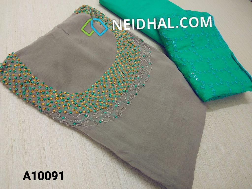 CODE A10091 : Designer Grey Georgette unsitched salwar material(requires lining) with Heavy french knot, thread and bead work on yoke, daman taping, Sea Green Silk cotton bottom, Heavy thread and sequins work on green Chiffon duaptta with laces.