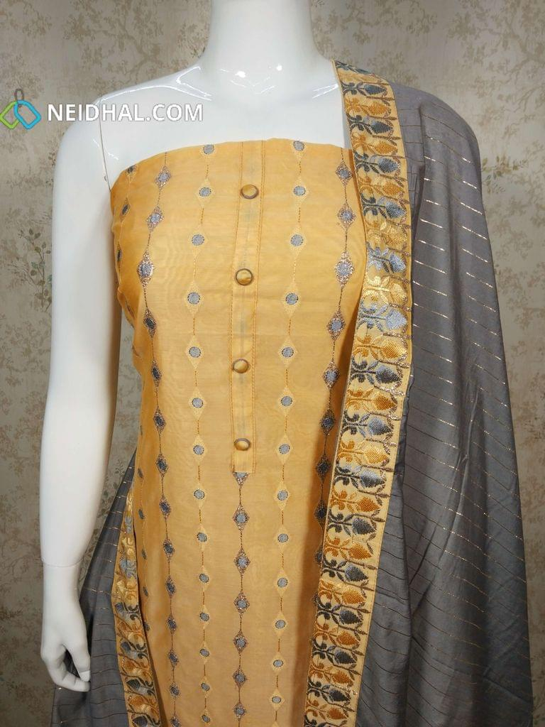 Premium Yellow Silk Cotton UnStitched salwar material(requires lining) with thread and zari embroidery work on front side, plain back side, drum dyed yellow cotton bottom, grey silk cotton dupatta with tapings
