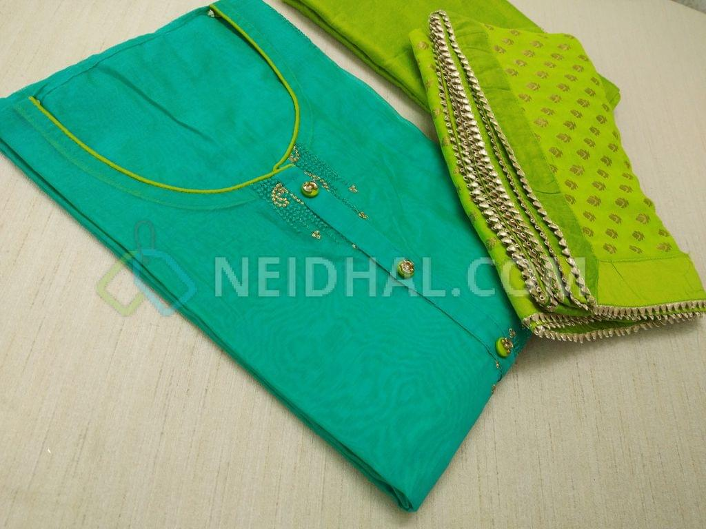 Turquoise Blue Chanderi unstiched salwar material(requires lining) with heavy thread work and zari work on front side, plain back, fancy buttons and tassels, Green silk cotton bottom, golden weaving on Green Georgette duappa with fancy borders.