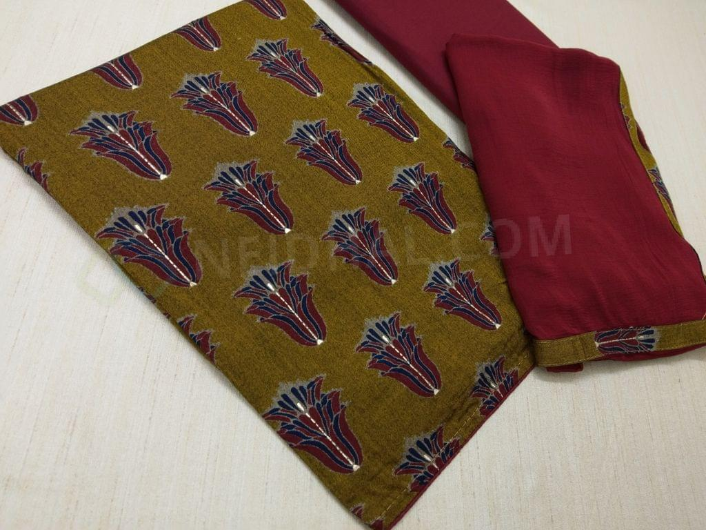 Printed Yellow Modal Fabric(Flowy Fabric) unstitched salwar material with folden prints, Maroon cotton bottom, Maroon Chiffon dupatta with taping