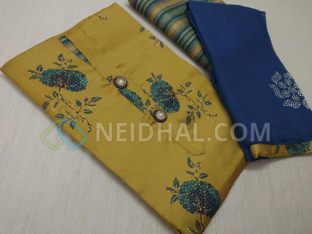 Designer Mehandi Yellow soft Silk Unstiched Salwar material(requires lining) with contrast prints, Printed Soft silk bottom, Blue Chiffon dupatta with dew drops work and taping.