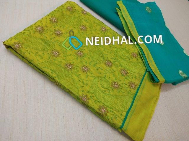 Green Silk Cotton unstitched Salwar material(requires lining) with heavy thread and zari work on front side, plain back, blue cotton bottom, blue chiffon dupatta with weaving and taping