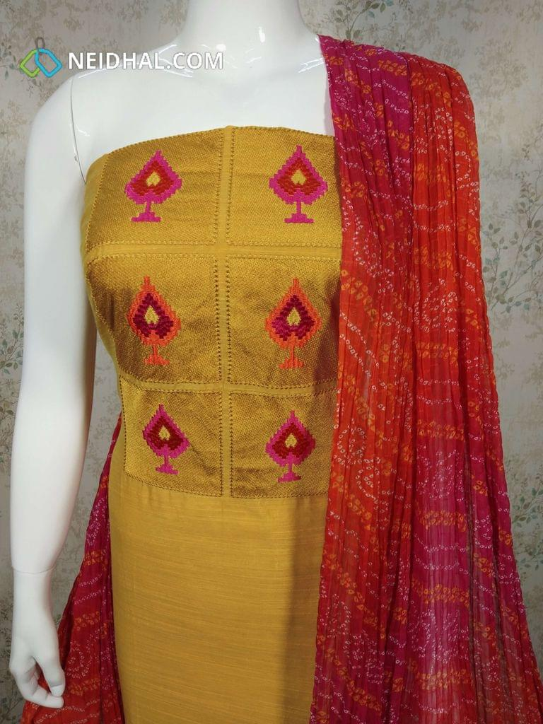 CODER : R13 Yellow Silk Cotton unstitched salwar material(requires lining) with embroidery work on yoke, plain back side, pink Cotton bottom, Bandhini printed chiffon dupatta with tapings