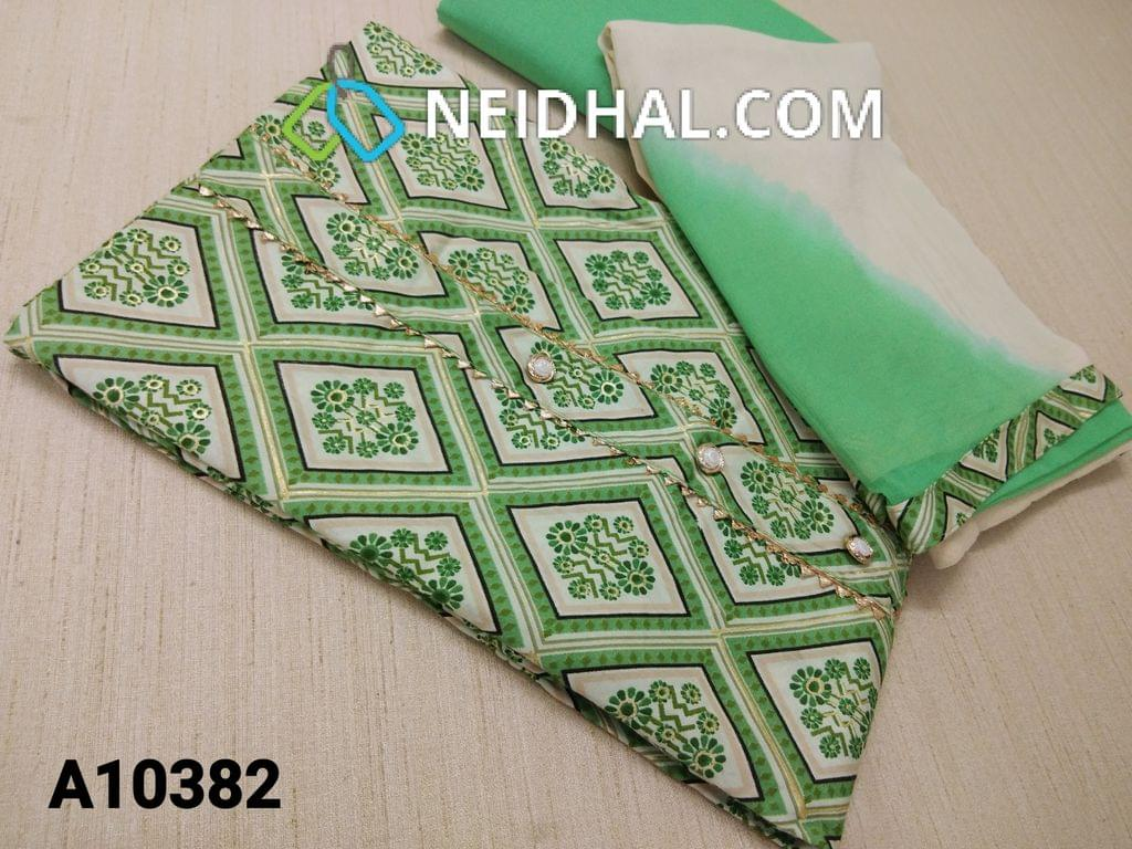 CODE A10382 : Printed Green Cotton unstitched salwar material(requires lining) wih golden prints, buttons on yoke, green cotton bottom, Dual color chiffon dupatta with tapings