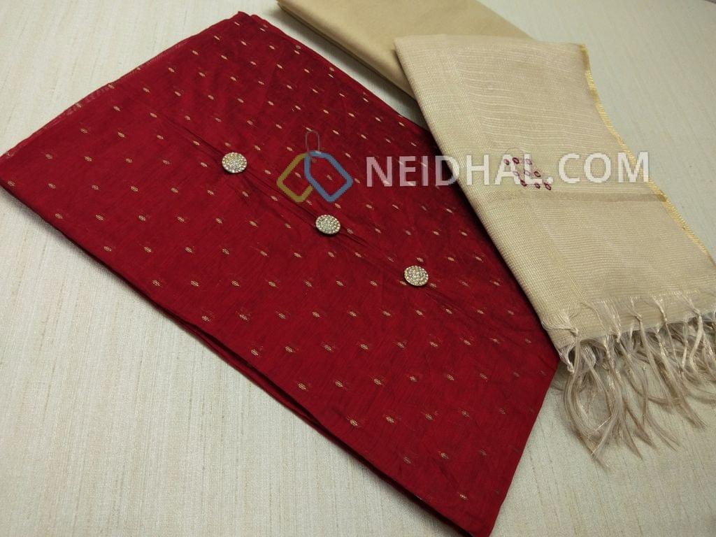 CODE R20 : Designer Maroonish Red Silk Cotton unstitched Salwar material(Requires lining) with zari butta work on either side, beige silk cotton bottom, foil mirror hand work on Tissue dupatta with tassels